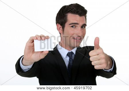 Thumbs up form n executive with blank business card