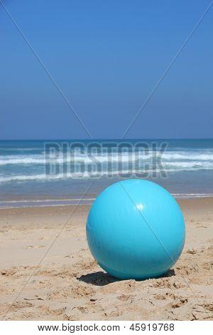 Ball left on a beach