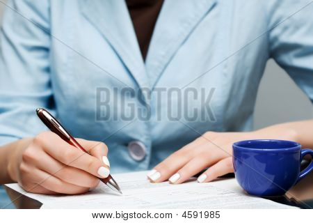 Businesswoman Signing The Contract.