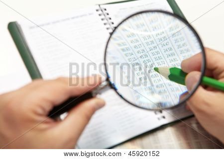 The Businessman And Magnifier