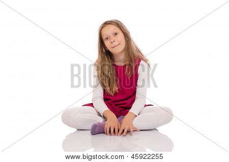 Young Girl Making Faces On The Floor
