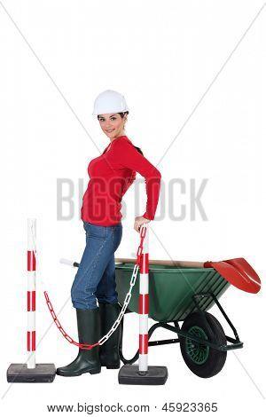 Road-side worker with wheelbarrow