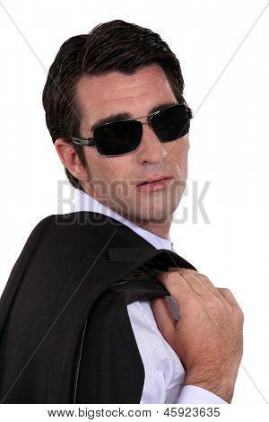 Man wearing dark sunglasses