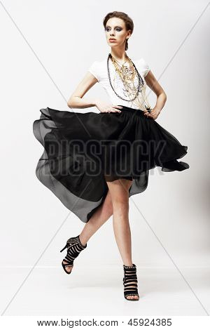 Motion. Vitality. Luxurious Supermodel In Fluttering Fashion Dress. Oscillation