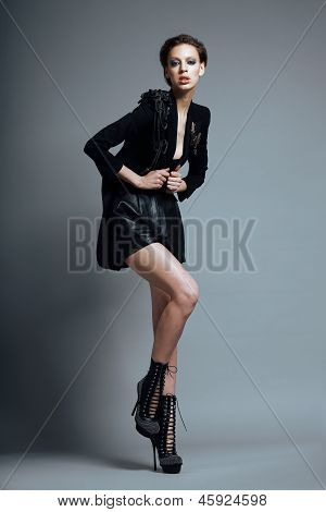 Vogue Style. Stylish Woman Fashion Model  In Trendy Black Clothes And Boots. Personality