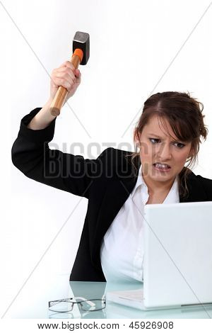 Corporate woman mad at her laptop.