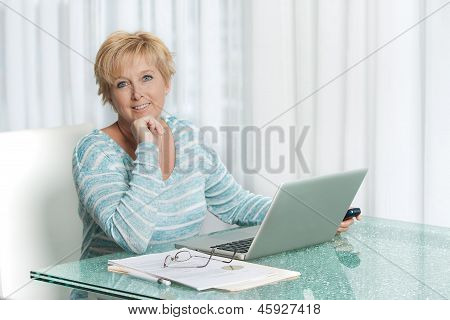 Woman using laptop to work from home