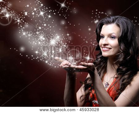 beautiful girl blowing magic stars