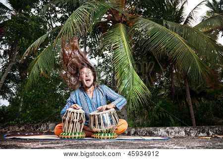 Tabla Player With Hair Up