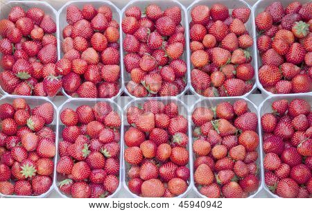 Strawberry background in the market of France.