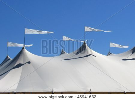 white tent with waving flags