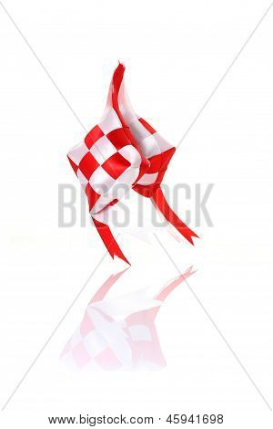 artificial with and red ketupat with reflection