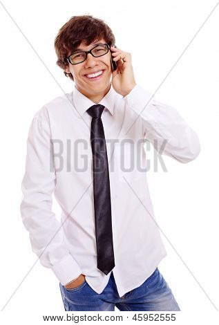 Smiling young man in white shirt, blue jeans and black glasses talking by mobile phone. Isolated on white background, mask included