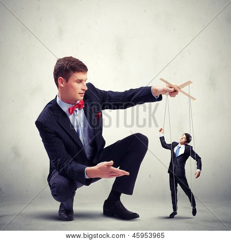 Businessman puppeteer