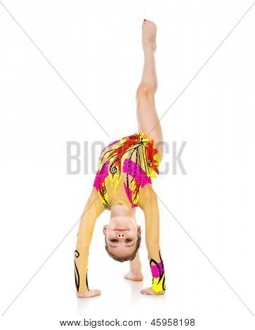 little girl gymnast standing on hands on a white background