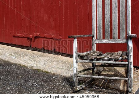 Old rocking chair and red wall