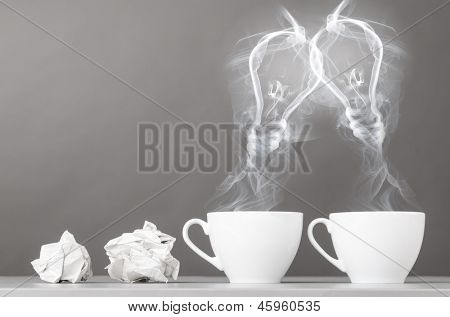 creating idea. bulbs silhouette from steaming hot coffee cup