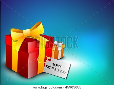 Happy Fathers Day celebration concept with gift boxes wrapped with ribbon and tag.