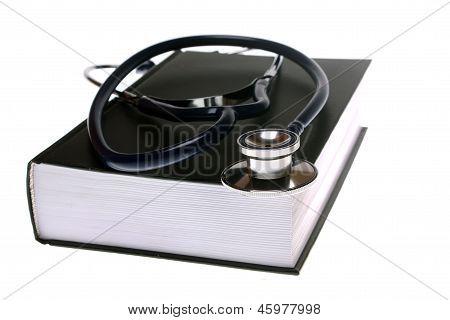 Stethoscope On Book Isolated On White Background