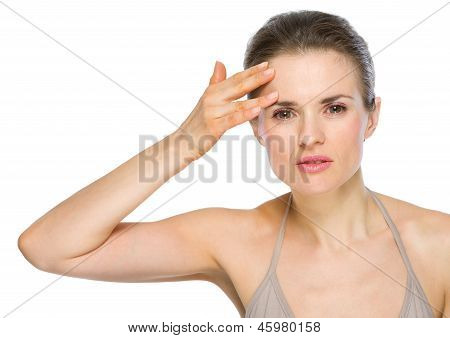 Beauty Portrait Of Young Woman Checking Facial Skin