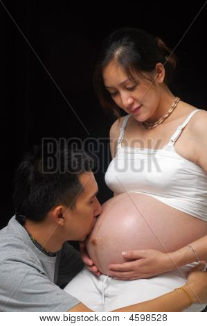 happy couple expecting newborn