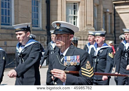 Members Of The British Armed Forces Marching Through Liverpool