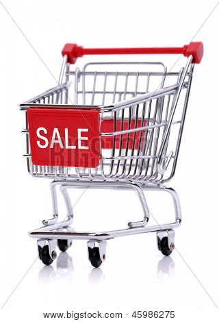 Sale sign on red shopping trolley isolated on white background