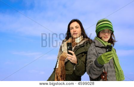Two Women With Cellphones