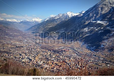 View Of City Of Aosta, Italy, And Its Valley