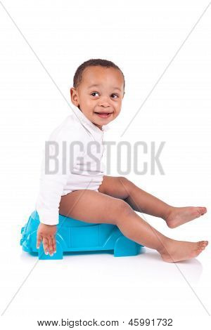 African Child On Potty, Isolated Over White