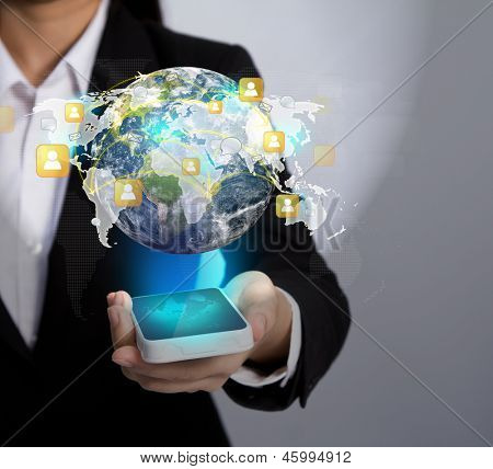 Hand holding Modern communication technology mobile phone show the social network (Elements of this image furnished by NASA)