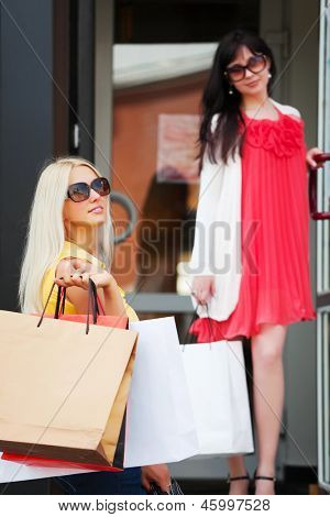Two young women with shopping bags
