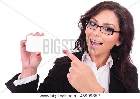 young business woman presenting an empty business card with a large smile on her face & looking at the camera. on white background