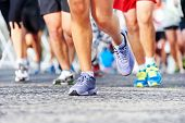 stock photo of recreate  - Marathon running race people competing in fitness and healthy active lifestyle feet on road - JPG