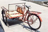 stock photo of rickshaw  - Red bicycle rickshaws goods and services background - JPG