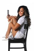 picture of african american hair styles  - Beautiful African American woman with cell phone sitting on a chair - JPG