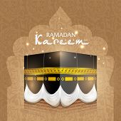 pic of kaba  - View of Qaba Shareef on abstract brown background with text Ramadan Kareem - JPG