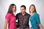 stock photo of threesome  - young people in various poses on studio set - JPG