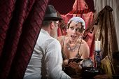 stock photo of nose ring  - Surprised fortune teller with customer and tarot cards - JPG