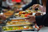 pic of buffet catering  - people group catering buffet food indoor in luxury restaurant with meat colorful fruits  and vegetables - JPG