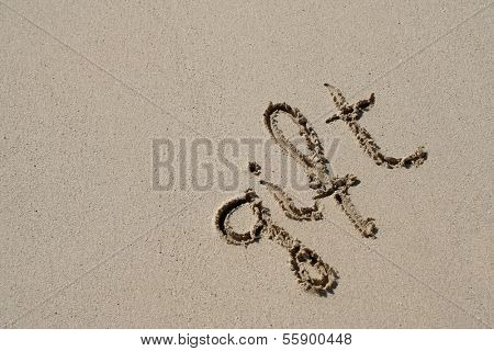 Concept or conceptual hand made or handwritten gift text in sand on a beach in an exotic island