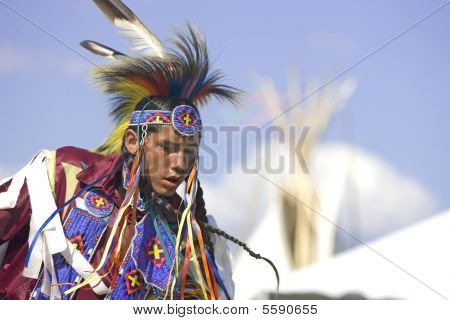 Native American man in full dress.