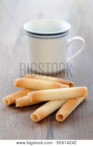 Waffle Roll On The Table With Tea Cup