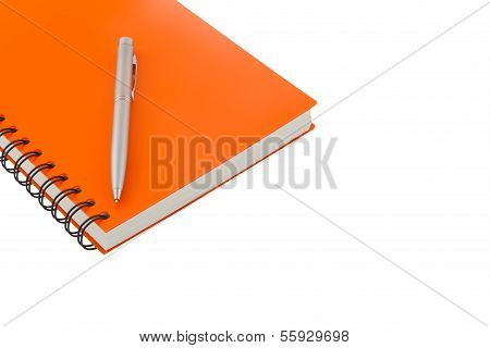 Notebook Spiral Bound And Pen On White Background