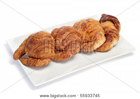 some croissants on a plate, on a white background