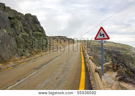 Mountain road, traffic warning sign double bend
