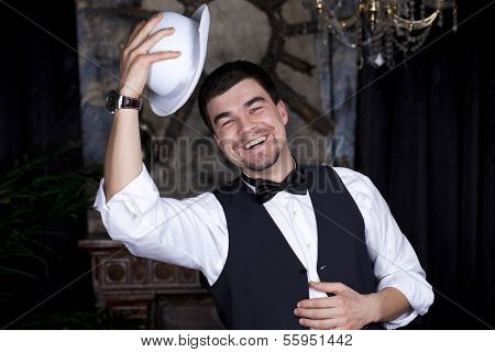 Happy man in a white bowler hat