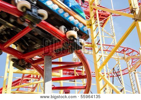 Small Rollercoaster On Blue Sky