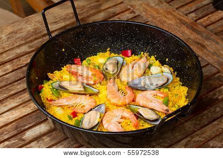 Paella in black pan