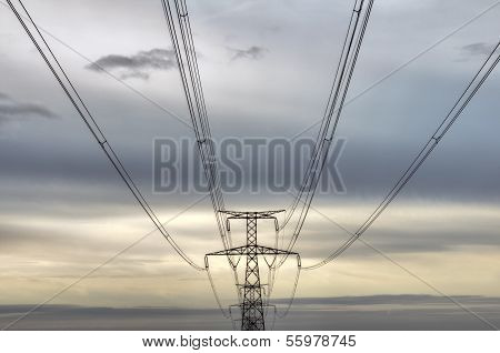 high voltage pylons silhouettes